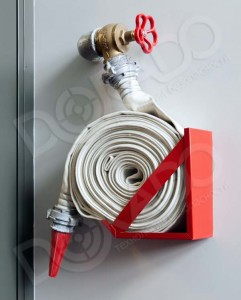 Fire-hose on the wall in a modern building